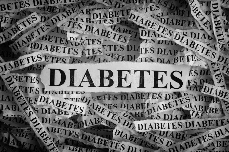 Torn pieces of paper with the word DIABETES. DIABETES. Torn pieces of paper with the word DIABETES. Concept Image. Black and White. Closeup stock image