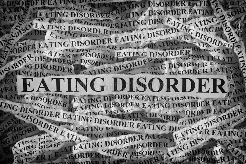 Torn pieces of paper with the words Eating Disorder stock images