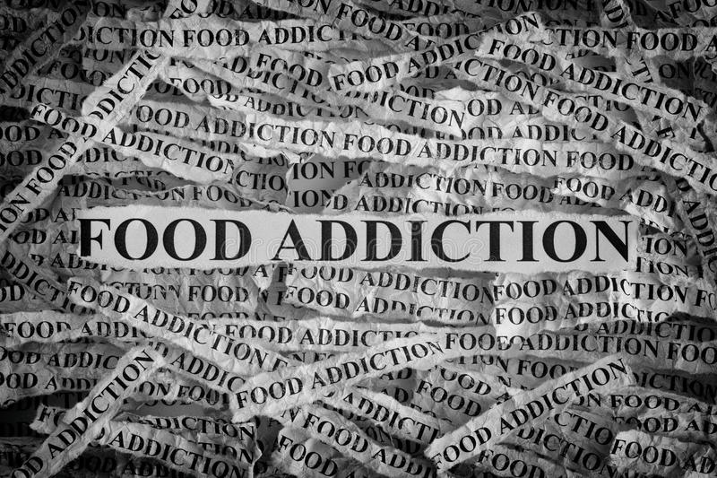 Torn pieces of paper with the words Food Addiction stock images