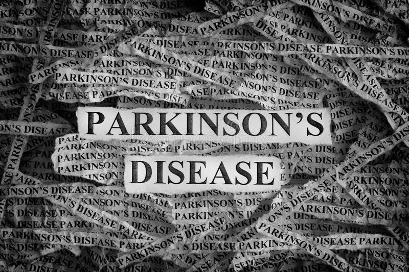 Torn pieces of paper with the words Parkinson`s disease. Parkinson`s disease. Torn pieces of paper with the words Parkinson`s disease. Concept Image. Black and royalty free stock photo