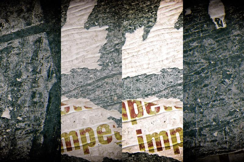 Torn poster after vote on tin textured wall. Ripped newspaper royalty free stock photos