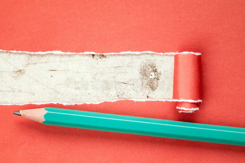 Torn red paper and pencil royalty free stock photos
