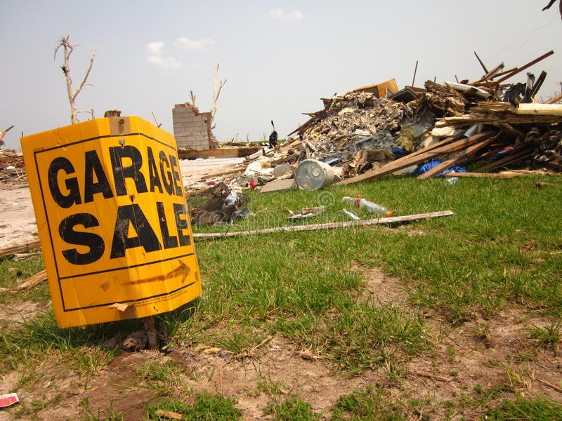 Tornado damage with garage sale sign royalty free stock photography