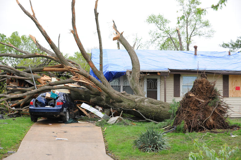 Tornado Damage In Saint Louis. SAINT LOUIS, MISSOURI - APRIL 23: Damaged home with tarp-covered roof after tornadoes hit the Maryland Heights area on Friday royalty free stock image