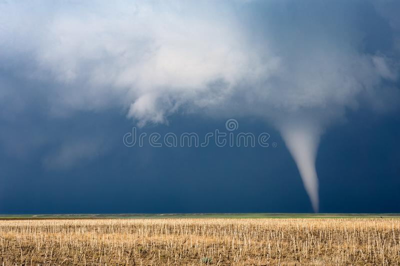 Tornado with dark clouds and stormy sky royalty free stock photography