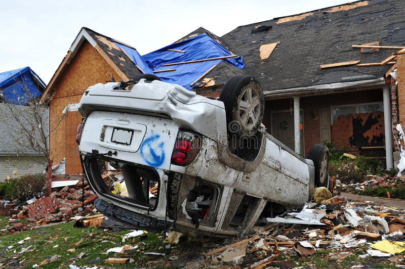Tornado destruction of car and home. ST. LOUIS - APRIL 25, 2011: Dozens of homes and cars were destroyed by the April 22 Good Friday tornado that ran through St royalty free stock images