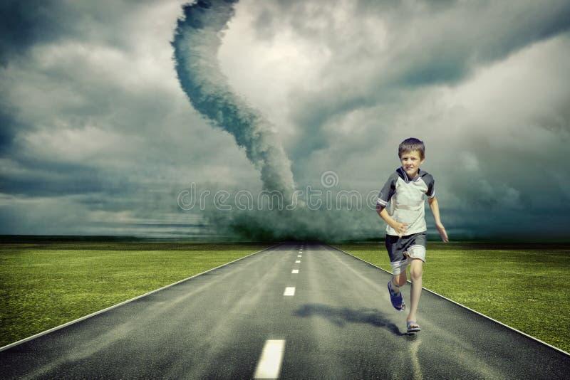 Tornado and running boy stock image