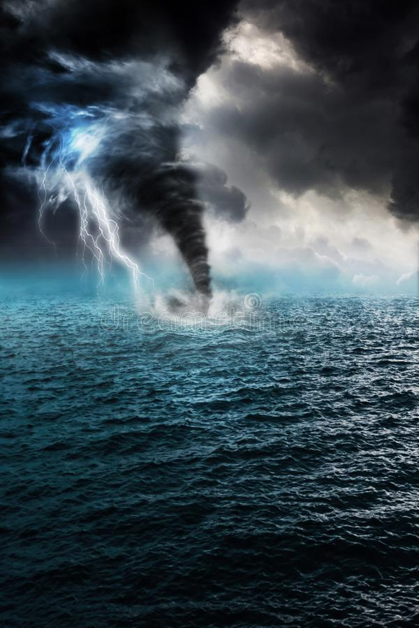 Tornado in the sea. And lightning storm royalty free stock photography
