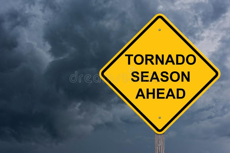 Tornado Season Ahead Caution Sign. With Storm Cloud Background stock images