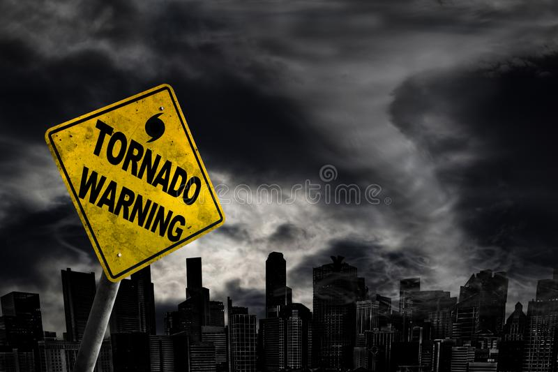 Tornado Warning Sign Against City Silhouette With Copy Space royalty free stock photo