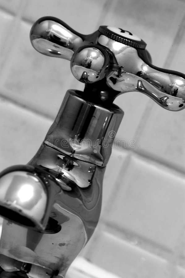 Torneira do banheiro fotografia de stock royalty free