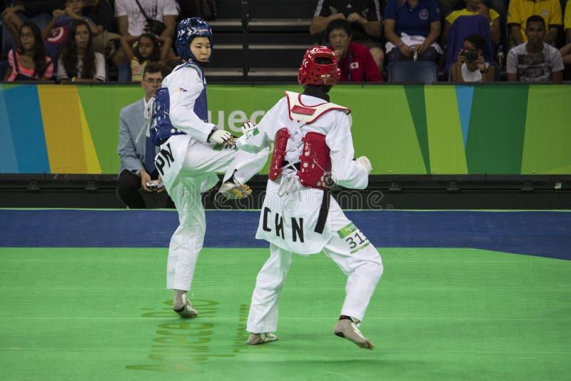 Torneo internacional del Taekwondo en Río - JPN contra CHN fotos de archivo