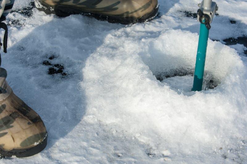tornillos del hielo para pescar imagenes de archivo