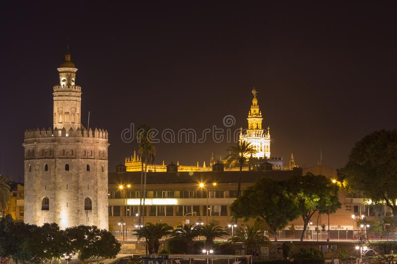 View on Torre del Oro and Giralda from calle Betis in Seville at night stock image