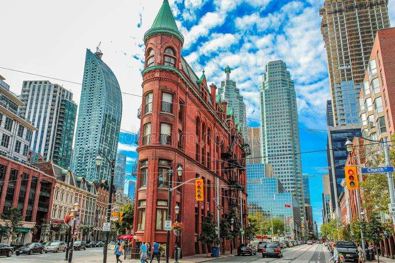 Toronto, Canada. The beautiful city of Toronto, Canada with its ancient and modern architecture that shows us the famous Gooderham Building, also known as stock photography
