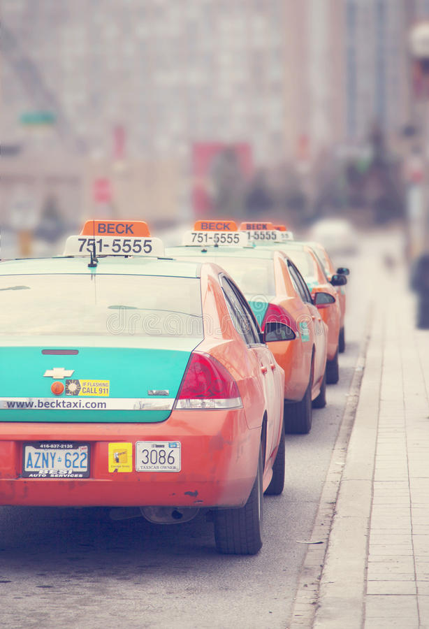 TORONTO, CANADA - APRIL 12: Taxi cabs lined up waiting for customer stock images
