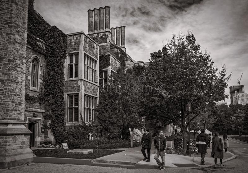 Toronto, Canada - 20 10 2018: Autumn scene with tourists walking in front of historic Hart House building. Hart House is stock photography