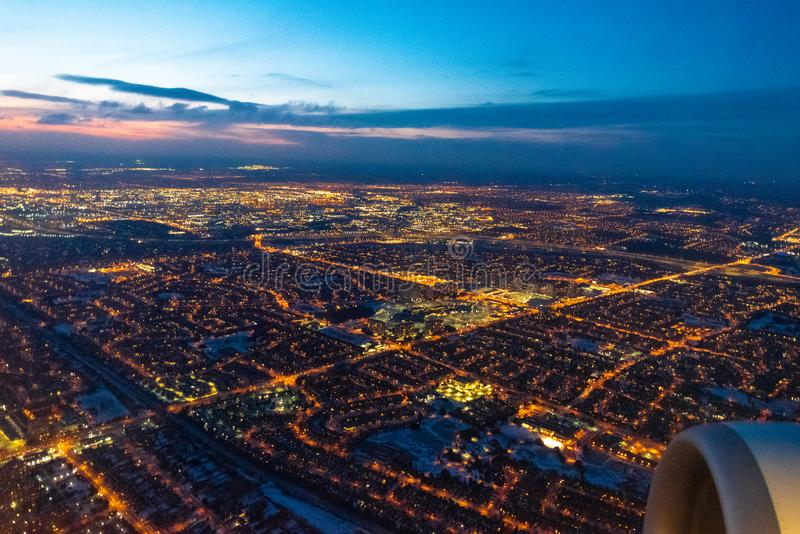 Toronto, Canada, city lights aerial view. Toronto, Canada, aerial view of the city lights as a commercial plane lands in the Pearson International Airport stock image