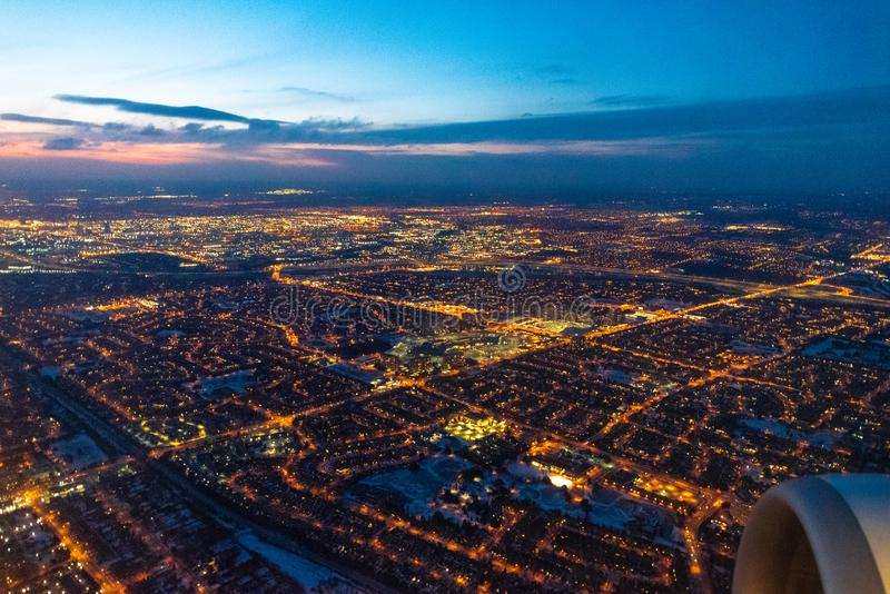 Toronto, Canada, city lights aerial view. Toronto, Canada, aerial view of the city lights as a commercial plane lands in the Pearson International Airport stock photo