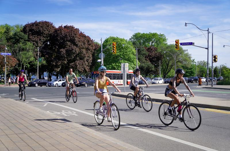 Toronto, Canada - 06 09 2019: Dedicated bicycle lanes in Toronto are in high demand by Torontonians. Riding a bike along stock photo