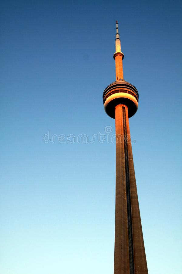 TORONTO, CANADA - JANUARY 8. 2012: Isolated CN Tower rising high into clear blue sky stock images