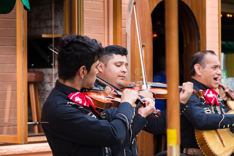 TORONTO, ON, CANADA - JULY 29, 2018: A mariachi band plays in front of a crowd in Toronto`s vibrant Kensington Market. stock photos