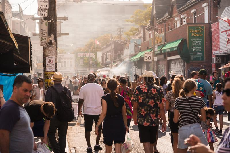 TORONTO, ON, CANADA - JULY 29, 2018: Street view of the crowd at Kensington market in Toronto. royalty free stock photo