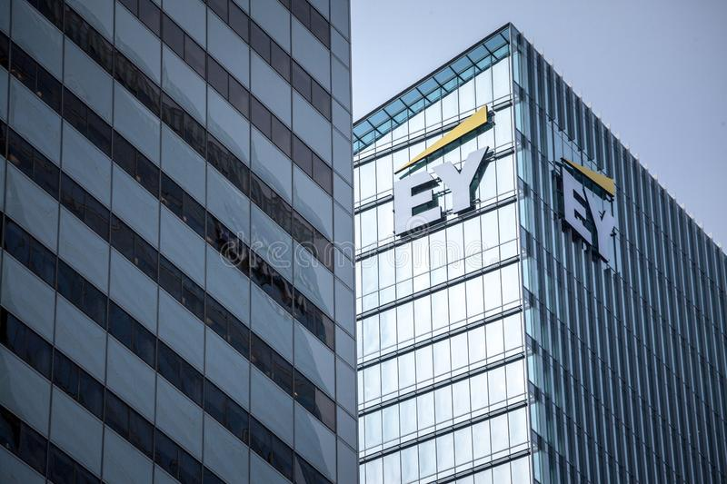 Ernst and Young EY logo on their main office for Toronto, Ontario. TORONTO, CANADA - NOVEMBER 13, 2018:EY is one of the leading companies in Business Services royalty free stock photography