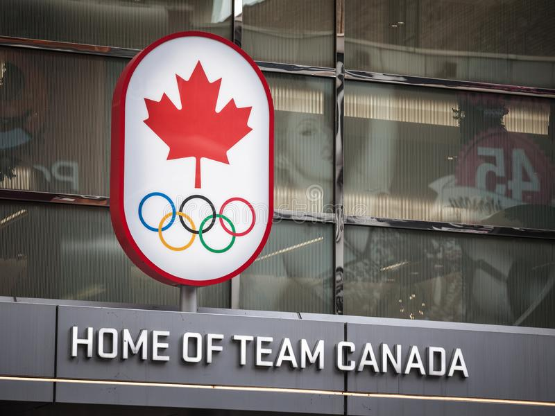 Canadian Olympic Committee logo with the Olympic rings, also called Team Canada. TORONTO, CANADA - NOVEMBER 13, 2018: Picture of the official logo of the stock photo