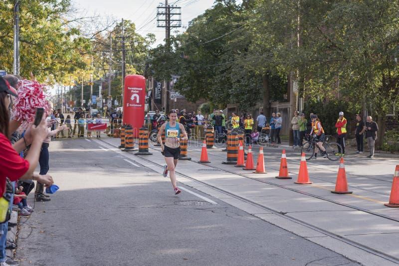 TORONTO, ON/CANADA - OCT 22, 2017: Canadian marathon runner Leslie Sexton passing the 33km turnaround point. At the 2017 Scotiabank Toronto Waterfront Marathon royalty free stock photos