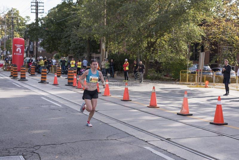 TORONTO, ON/CANADA - OCT 22, 2017: Canadian marathon runner Leslie Sexton passing the 33km turnaround point. At the 2017 Scotiabank Toronto Waterfront Marathon royalty free stock photo