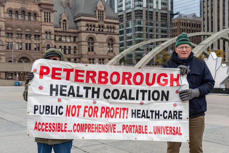 Toronto, Canada, Protest against Doug Ford`s Governement to Publ. Toronto, Canada: A sing of the Peterborough Health Coalition. Protest against cuts to the royalty free stock image