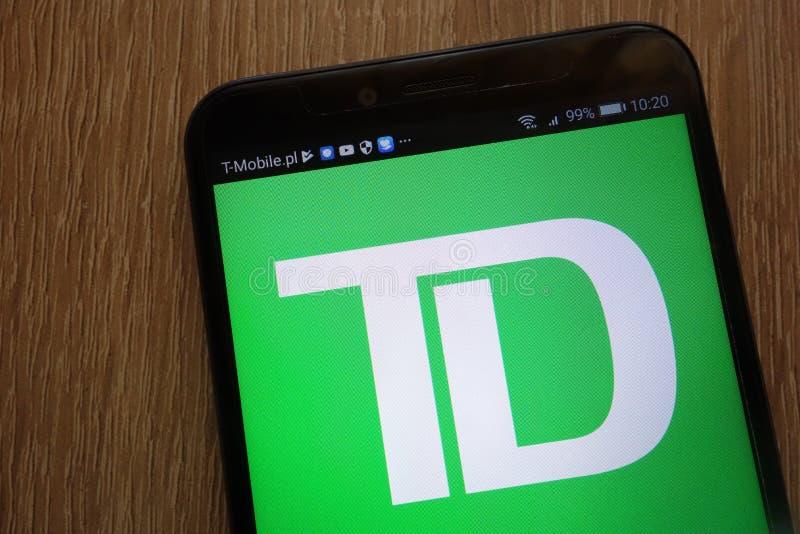 Toronto-heerschappij Bankembleem op een moderne smartphone wordt getoond die royalty-vrije stock foto