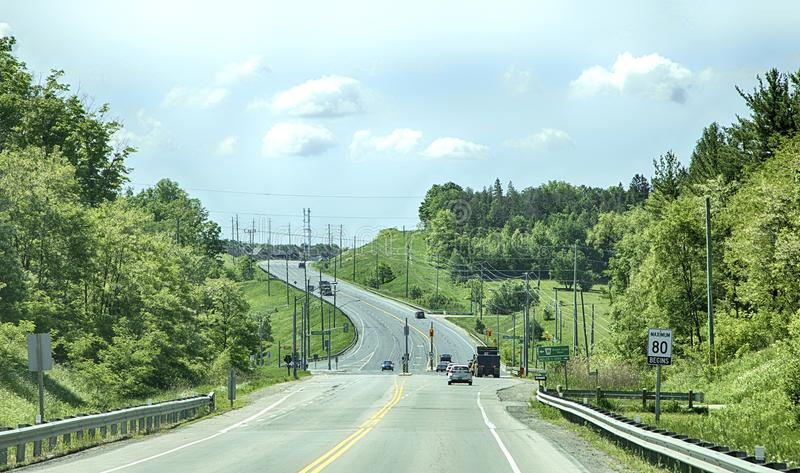 TORONTO - JUNE 8, 2018 - A road leads to the outskirts of a Newmarket city, Canada. TORONTO - JUNE 8, 2018 - A road leads to the outskirts of a Newmarket city stock images