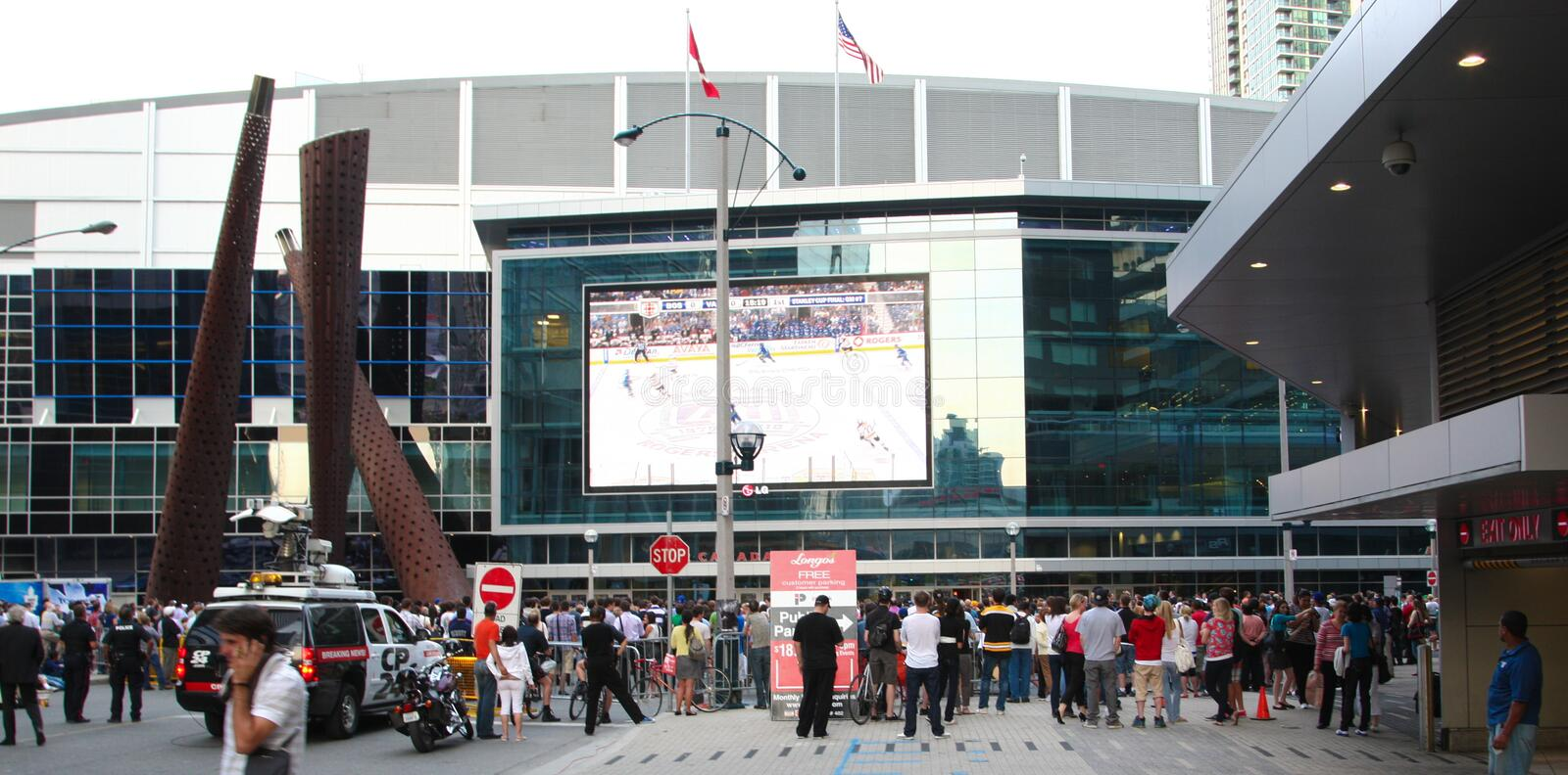 Toronto Maple Leaf hockey fans watching hockey game outdoor in downtown Toronto. Ontario Canada royalty free stock photos
