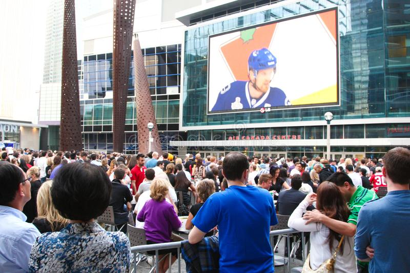 Toronto Maple Leaf hockey fans watching hockey game outdoor in downtown Toronto. Ontario Canada royalty free stock photo