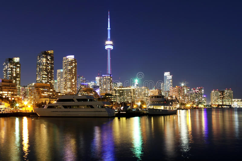 Toronto night skyline background with colorful reflections. Toronto skyline at night over lake with colorful reflections stock photos