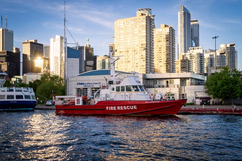 Toronto, Ontario, Canada - 2019 06 09: Toronto Fire Rescue red boat beside the pier in front of Toronto Fire Marine royalty free stock images
