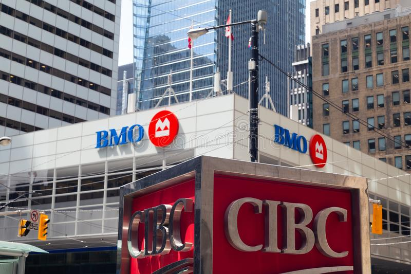 Toronto, Ontario/Canada - July 2018: Bank of Montreal BMO and Canadian Imperial Bank of Commerce CIBC signs logos head office king royalty free stock photo