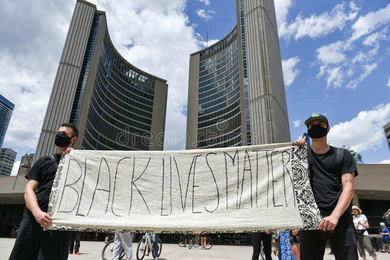 Thousands of people took to Toronto streets in separate events to protest anti-black racism stock photos