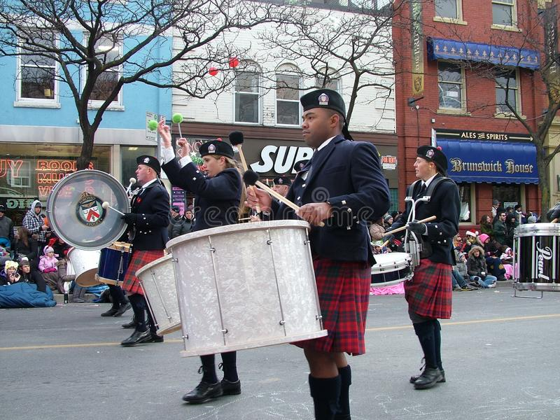 The Toronto Police Pipe Band at Toronto`s 106th annual Santa Claus Parade. November 21, 2010. royalty free stock photography