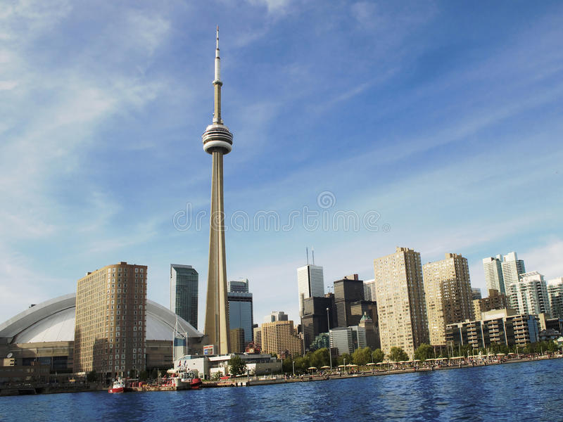 Toronto's Skyline with the CN Tower during the day. The beautiful Toronto's skyline with the famous CN Tower during the daytime. The area is a major royalty free stock photos