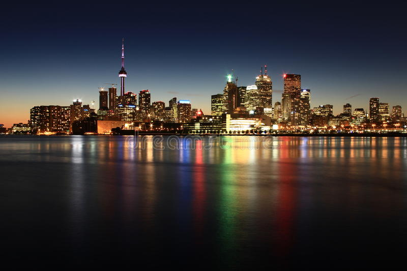 Toronto skyline in the evening. Toronto skyline and reflection in the evening stock photography