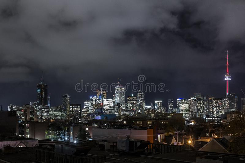 Toronto skyline, with the iconic towers and buildings of the Downtown and the CBD business skyscrapers at nights with lights. royalty free stock images