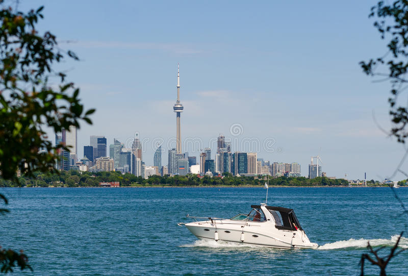 Toronto skyline and a power boat royalty free stock photography