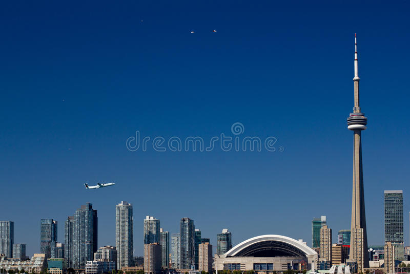Toronto skyline with a tower and airplanes royalty free stock photo