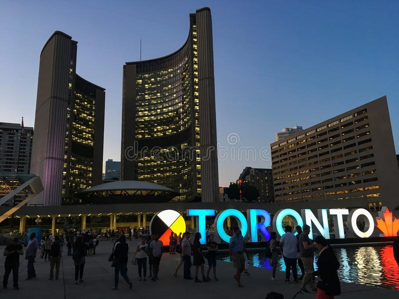 Toronto Square at sunset. Toronto sign in Square against city skyline at sunset in Canada stock photo