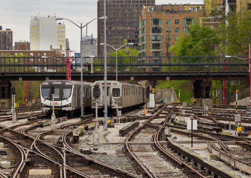 Toronto Subway Cars Parked. TORONTO, CANADA- 19TH MAY 2014: An old and New Subway train car parked next to each other on some tracks in Toronto royalty free stock photo