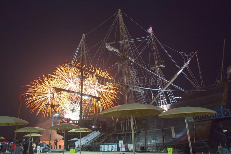 Toronto waterfront, Ontario, Canada - July 1st: People are watch. Ing Canada Day fireworks over Spanish 18th century Galleon Andalucia replica berthed at the royalty free stock photo