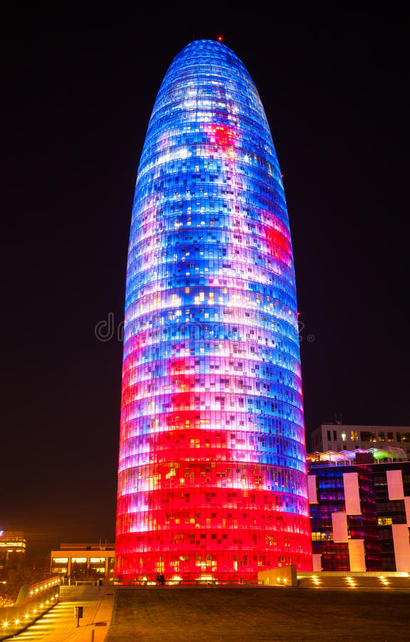 Torre agbar in night. BARCELONA, SPAIN - APRIL 12: Torre agbar in night in April 12, 2013 in Barcelona, Spain. 38 storey skyscraper, built in 2005 by Jean Nouvel stock photos